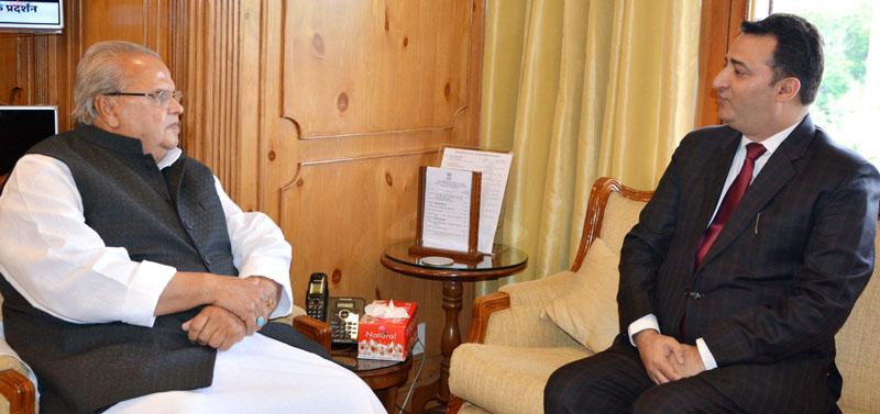 Member SCOC Rajiv Khajuria briefing Governor Satya Pal Malik on Wednesday.