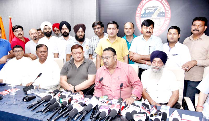 JCCI president Rakesh Gupta flanked by others addressing press conference in Jammu on Tuesday. -Excelsior/Rakesh