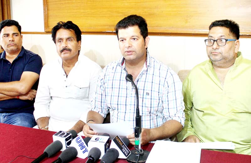 Contractors during a press conference at Jammu on Monday. -Excelsior Rakesh