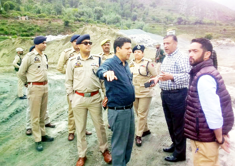 Divisional Commissioner Jammu, Sanjeev Verma inspecting National Highway at Ramban on Saturday.