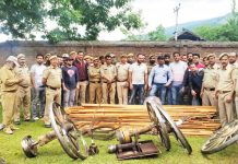 Officials of Forest Department showing seized material at DFO Office Bhadarwah. — Excelsior/Tilak Raj