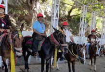 Pilgrims riding on ponies wearing helmets before leaving for Mata Vaishno Devi Ji Yatra.