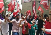 National Conference activists celebrating party's victory at Sher-e-Kashmir Bhavan on Thursday.