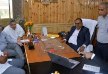 Speaker Legislative Assembly Dr Nirmal Singh chairing a meeting at Srinagar on Thursday.