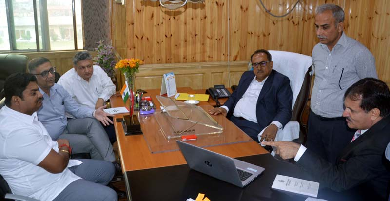 Speaker Legislative Assembly Dr Nirmal Singh chairing a meeting at Srinagar on Thursday.