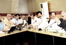 Members of governing body of SMVDNSH during a meeting at hospital premises on Monday.