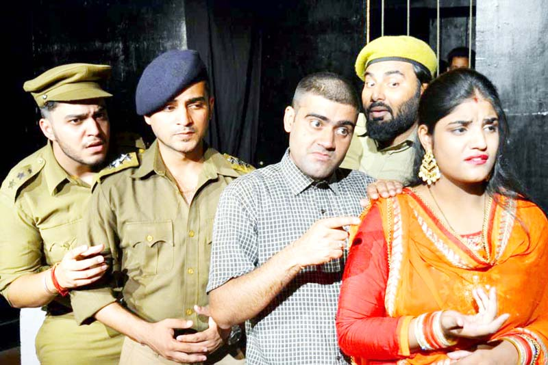 A scene from the play 'Mujrim Farar Hai' staged by Natrang in its Sunday Theatre.