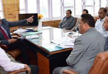 Advisors K Skandan and K Vijay Kumar chairing a meeting on Thursday.