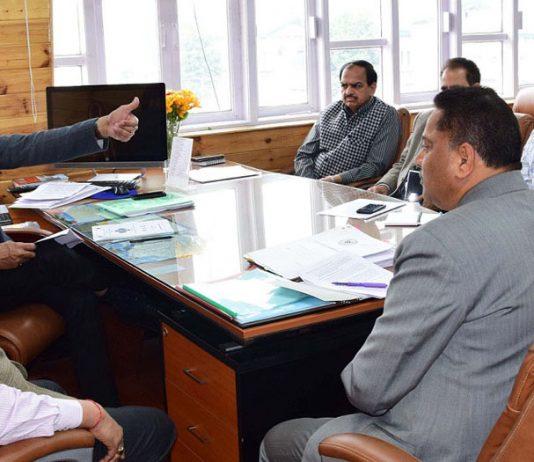 Advisors K Skandan and K Vijay Kumar chairing a meeting on Thursday.