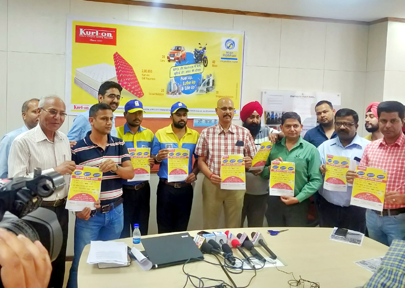 Rajesh Sharma, Territory Manager of BPCL for J&K along with other officials, launching company's lucky draw scheme at its Bahu Plaza office on Wednesday.