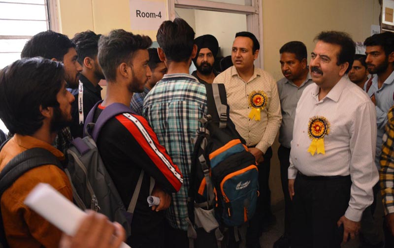 Director Technical Education, Dr Ravi Shankar Sharma interacting with students during Job Fest-2019 at Govt. Polytechnic Jammu on Saturday.