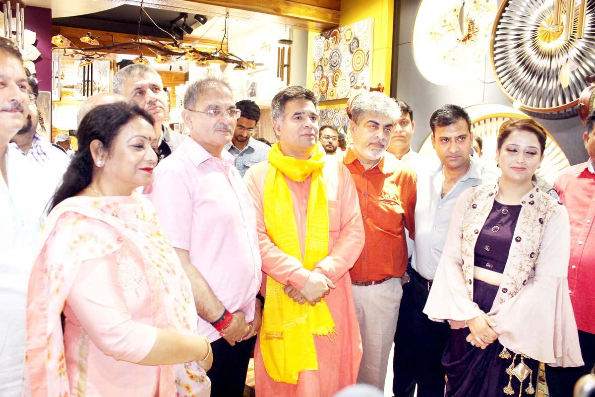 State President BJP Ravinder Raina, Ex-Deputy CM Kavinder Gupta and others during inauguration of Armonia Showroom at Channi Himmat, Jammu on Sunday.