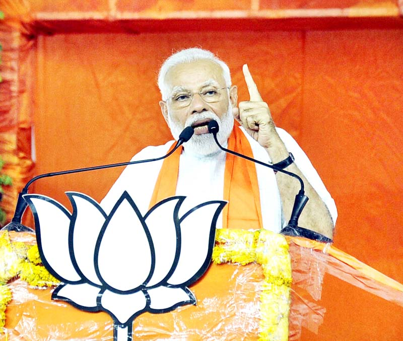 Prime Minister Narendra Modi addressing a public meeting at the BJP office in Ahmedabad on Sunday.(UNI)