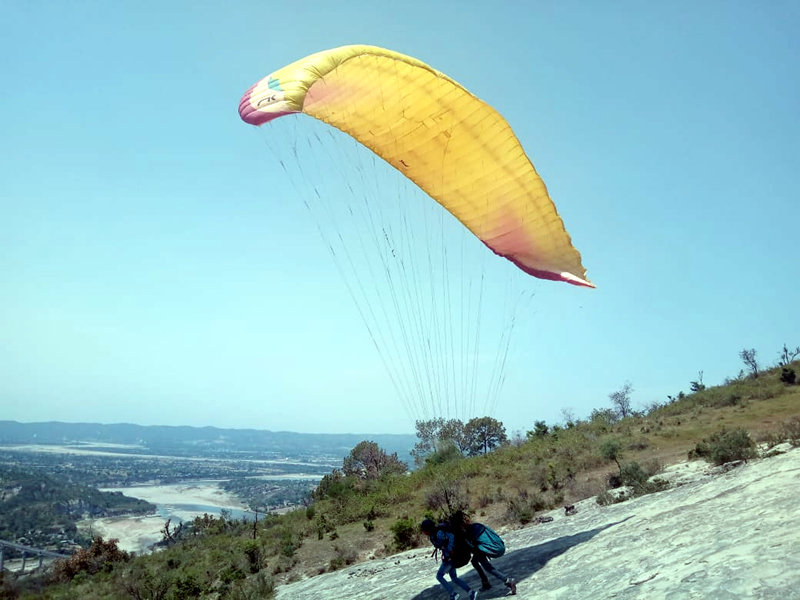 Paraglider taking off for flight at Aitham.