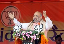 BJP National President Amit Shah addressing an election rally, in Dhanbad on Wednesday. (UNI)