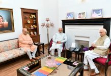 Prime Minister Narendra Modi and BJP National President Amit Shah blessed by L K Advani after Party's historical victory in General Election 2019, in New Delhi on Friday. (UNI)
