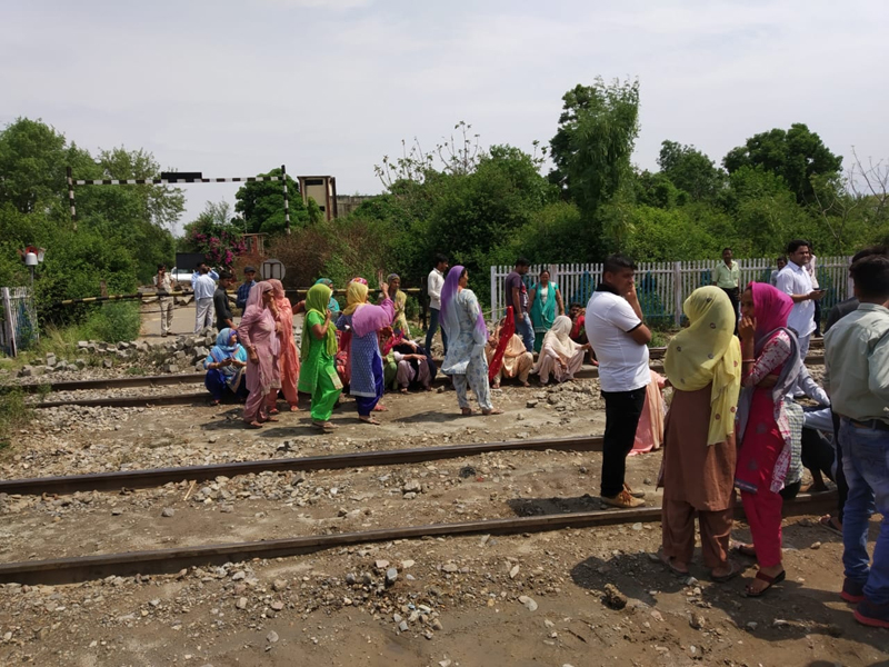 Border residents protesting on railway track at Ghagwal on Thursday.
