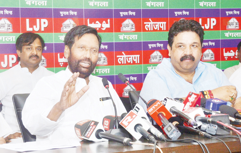 Union Minister and Lok Janshakti Party president Ram Vilas Paswan addressing a press conference at his residence in New Delhi on Wednesday. (UNI)