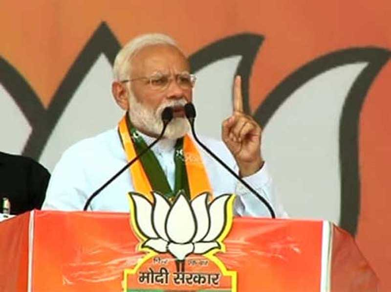 Prime Minister Narendra Modi addressing an election campaign rally on Friday. (UNI)