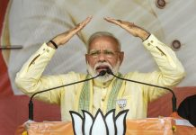 Prime Minister Narendra Modi addresses an election rally for the last phase of Lok Sabha polls, on Tuesday.