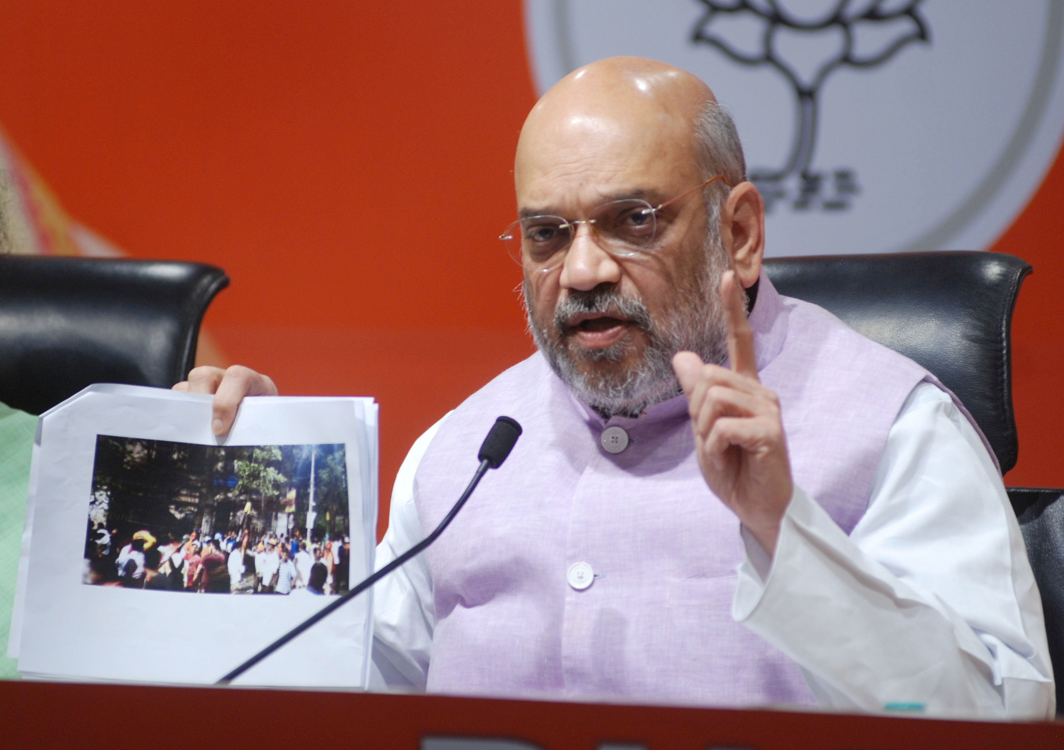 BJP National President Amit Shah addressing a press conference on violence during his national election campaign in West Bengal on Tuesday, in New Delhi on Wednesday. (UNI)