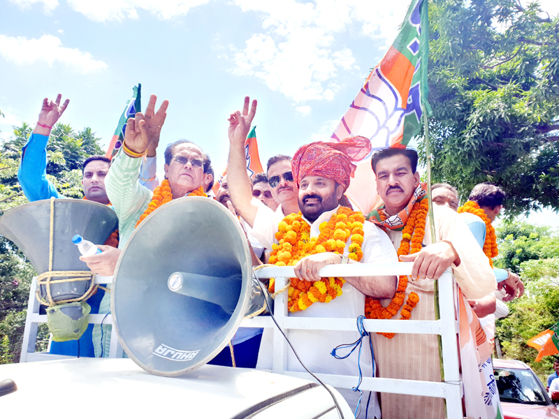 Senior BJP leader, Bali Bhagat during a rally at Raipur-Domana in Jammu on Sunday.