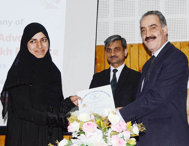 Chairman JKSJA, Justice Ali Mohammad Magrey handing over certificate to an advocate.