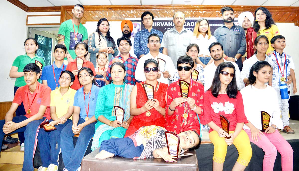 Winners of dance and song competition organised by 'Nirvana Academy' posing for a group photograph at Jammu on Tuesday.
