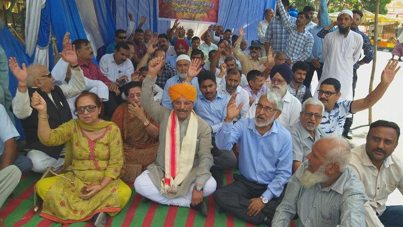 Members of Dogra Sadar Sabha staging protest dharna at Jammu on Tuesday.