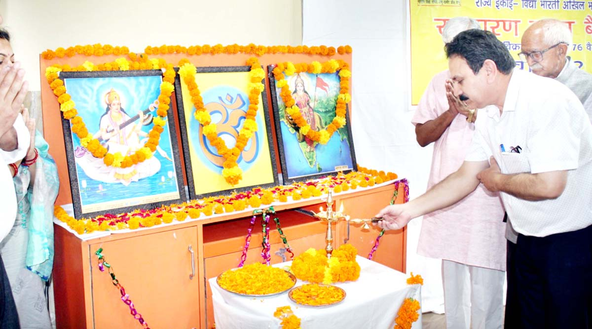 Guests lighting lamp during inaugural of Annual General Council of Vidya Bharti, State unit on Tuesday.
