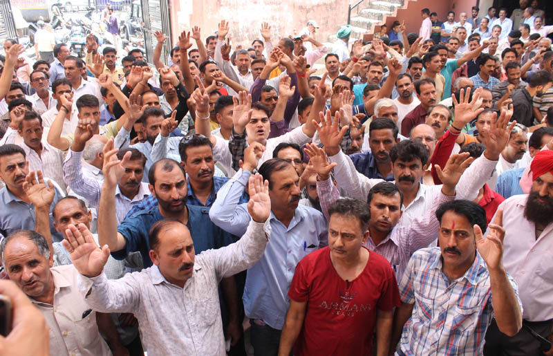 PHE workers conducting 'Gherao' of Chief Engineer's office at BC Road during protest in Jammu on Tuesday. -Excelsior/Rakesh