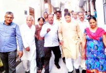 Senior BJP leader, Sat Sharma during visit of Ward No. 36 in Jammu on Tuesday.