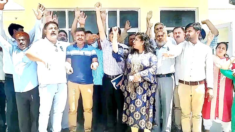 Sarpanchs raising slogans during protest.