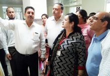 GMC Principal inspecting work on Maternity Hospital.