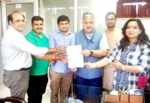 CUJ Shaikshik Sangh presenting charter of demands to Vice-Chancellor Prof Ashok Aima.