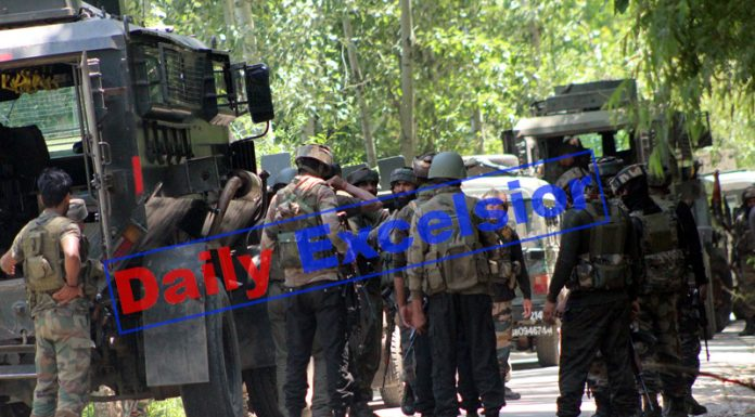 Troops at Dragad, Shopian during encounter with militants on Friday. -Excelsior/Younis Khaliq