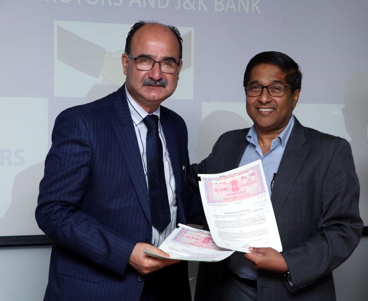 Syed Shafat Hussain, vice-president, J&K Bank posing with RT Wasan, vice-president, Sales & Marketing, CVBU, Tata Motors, after signing MoU.