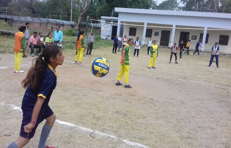 A player serving during the final of under-14 girls Volleyball event at GHS Satwari Cantonment in Jammu on Friday.