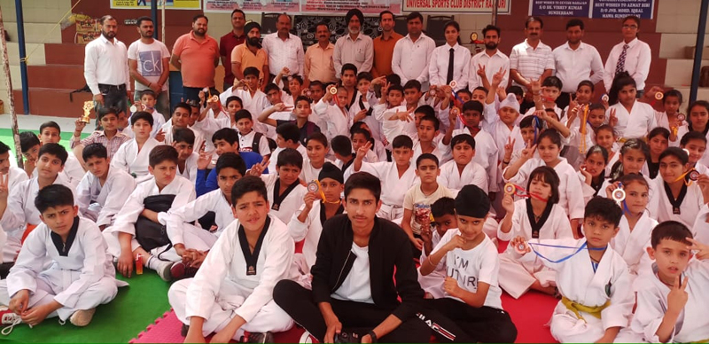 Young Karatekas posing for a group photograph during closing ceremony of Karate Championship in Sunderbani.