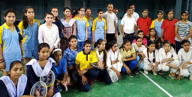 Players posing along with dignitaries and officials during inaugural ceremony of District Level inter School tournament at Udhampur.