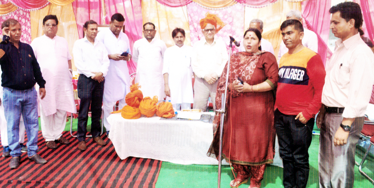 Corporator, JMC Ward No 34, Rani Devi addressing the gathering during a religious function at Jammu.