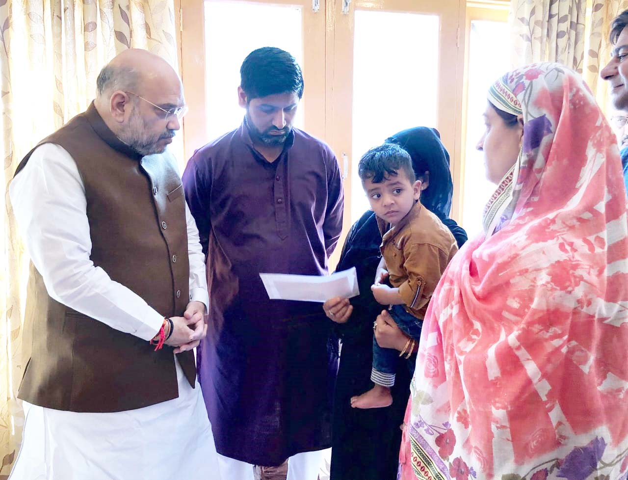 HM Shah visits family of Inspector killed in Anantnag terror attack