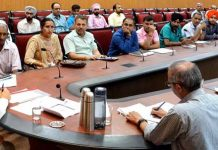 Advisor K K Sharma attending public grievances at Jammu on Saturday.