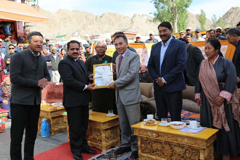 Justice Rabstan presenting memento to a member during fuction at Leh.