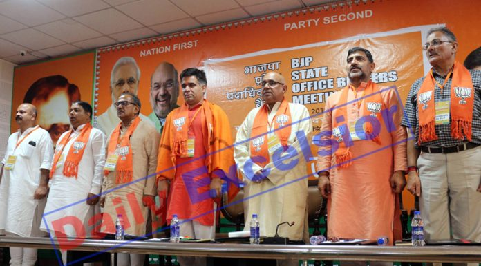 BJP leaders during recitation of National Anthem at Party's office bearers meeting at Jammu on Saturday. -Excelsior/Rakesh