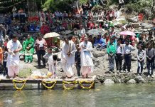 Tawi Darshan Aarti being performed at Dudu in Udhampur on Saturday.