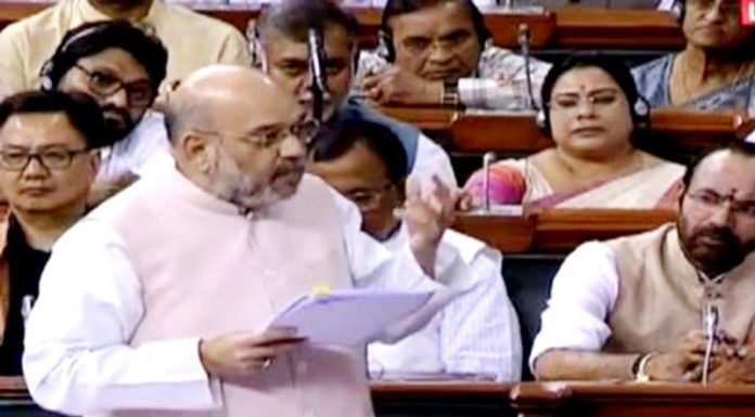 Union Home Minister Amit Shah speaking in the Lok Sabha on Friday.