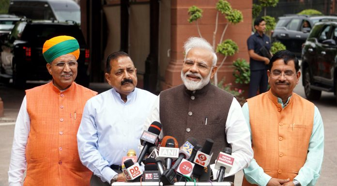Prime Minister Narendra Modi speaking to reporters on his arrival at Parliament House to attend the first session of the 17th Lok Sabha, in New Delhi on Monday. (UNI)