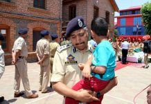 SSP Srinagar Dr Haseeb Mughal breaks down as he carries son of martyr Inspector Arshad Ahmed Khan during wreath laying ceremony in DPL Srinagar on Monday.