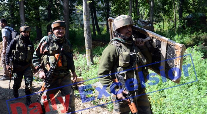 Troops at the site of encounter in Budgam on Friday. -Excelsior/Shakeel